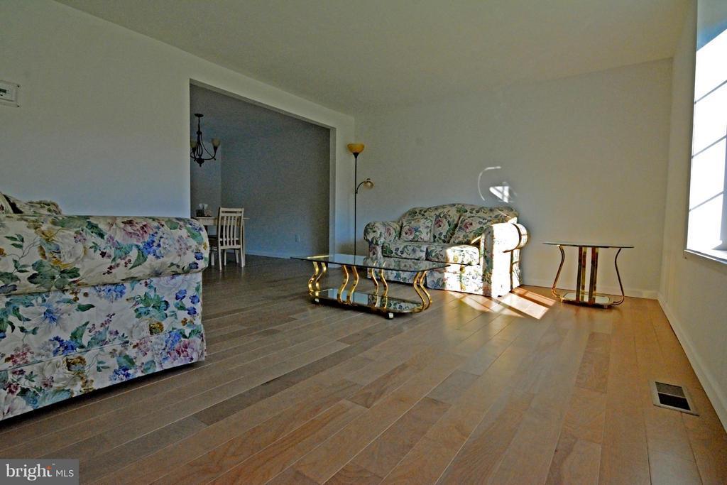 Living Room with Hardwood Floors - 7307 BONNIEMILL LN, SPRINGFIELD