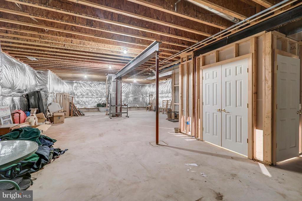 Unfinished Portion of Basement - Storage! - 27429 BRIDLE PL, CHANTILLY