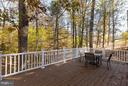 Private composite deck overlooking your woods. - 9879 HEMLOCK HILLS CT, MANASSAS