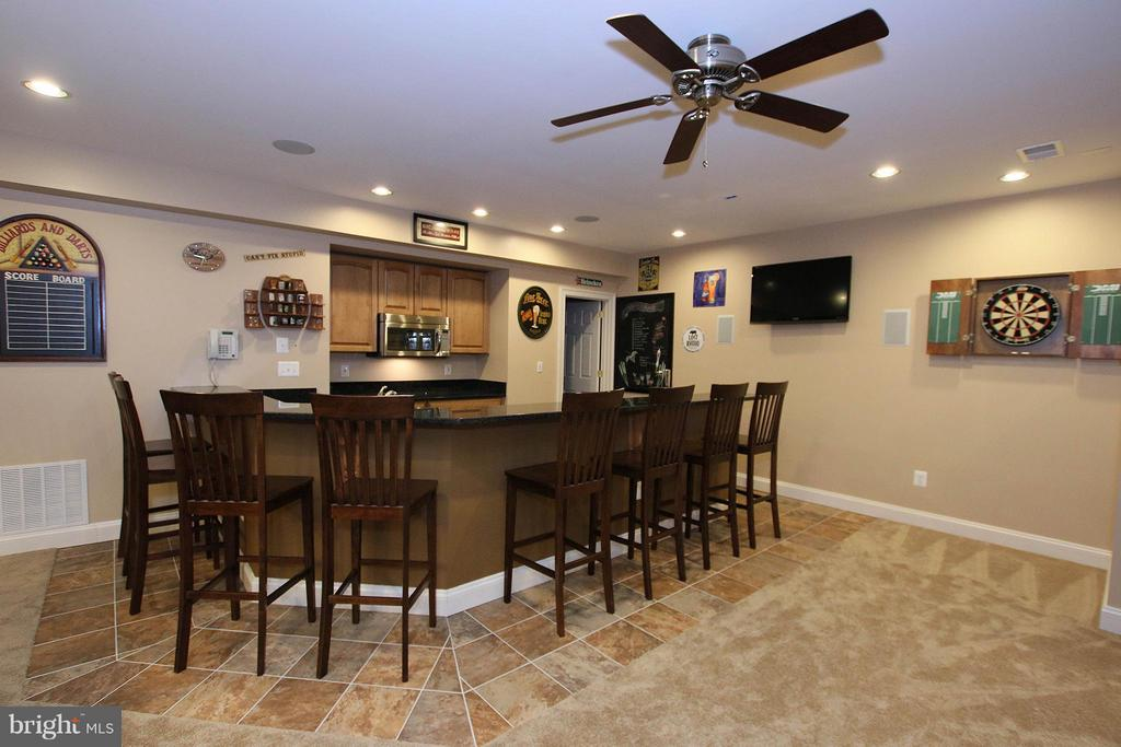 Nicely-equipped wet bar in the billiards room - 18733 GROVE CHURCH CT, LEESBURG