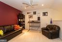 Loft space with half-bath and Redskins themed wall - 11314 WESTBROOK MILL LN #303, FAIRFAX
