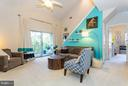 Vaulted ceilings in the roomy living area - 11314 WESTBROOK MILL LN #303, FAIRFAX