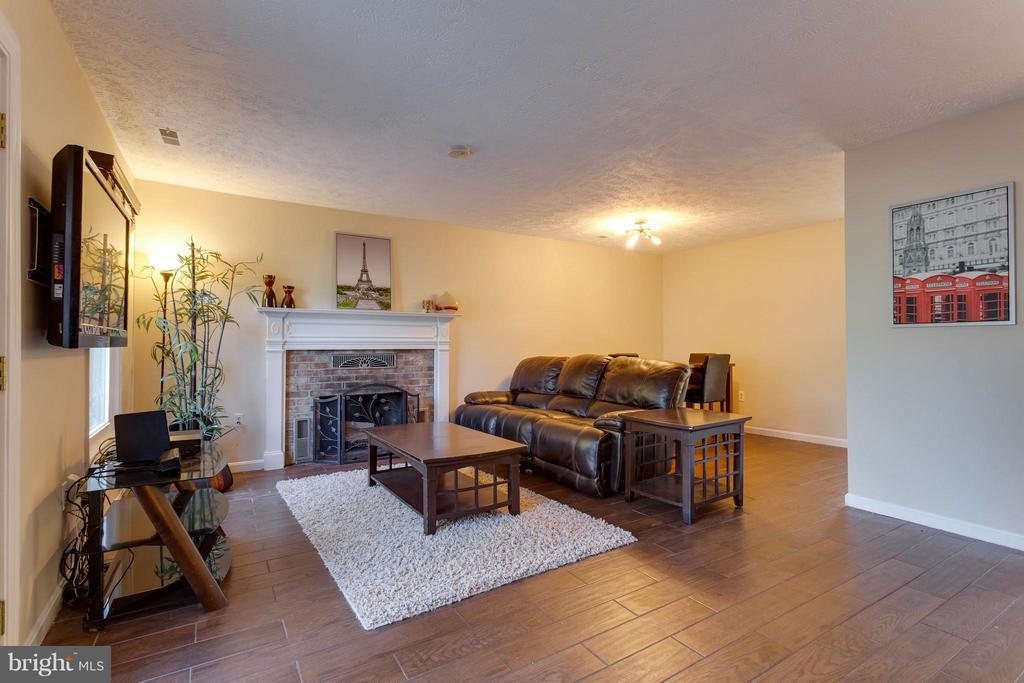 View of living room and dining room - 9094 FLORIN WAY, UPPER MARLBORO