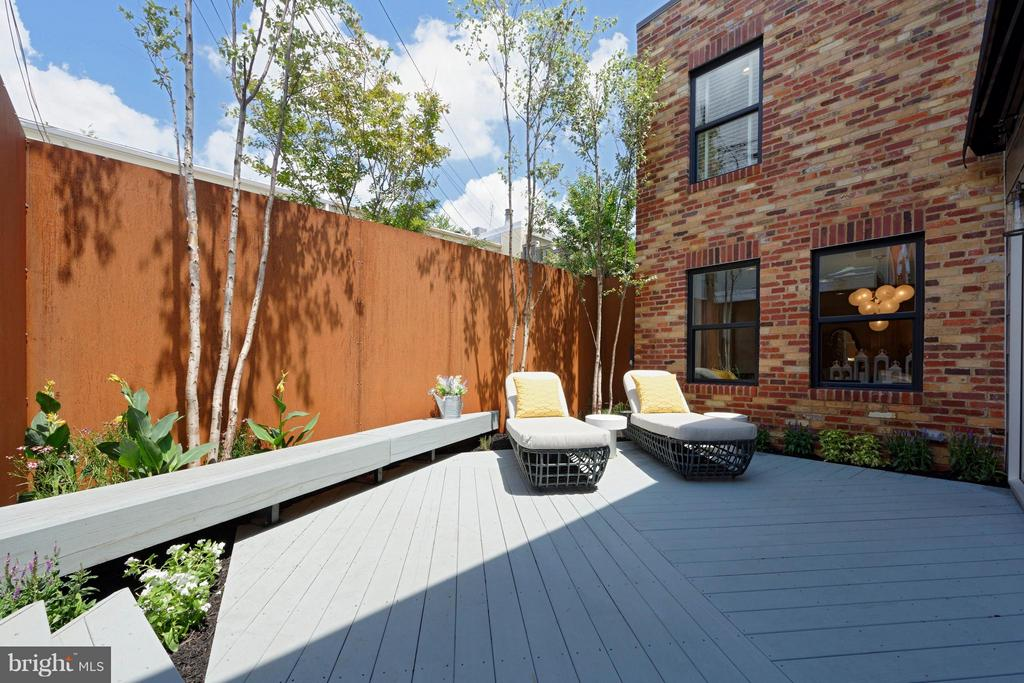 Modern patio with corten walls and cedar decking. - 322 ADOLF CLUSS CT SE #N, WASHINGTON