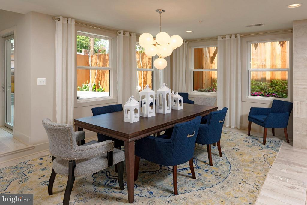 Dining Room looks onto the patio and landscaping. - 322 ADOLF CLUSS CT SE #N, WASHINGTON