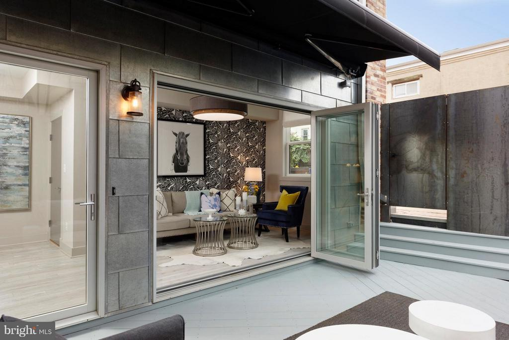 Sliding glass wall with retractable awning. - 322 ADOLF CLUSS CT SE #N, WASHINGTON