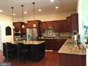 Island with pendant lighting. - 6 SCARLET FLAX CT, STAFFORD