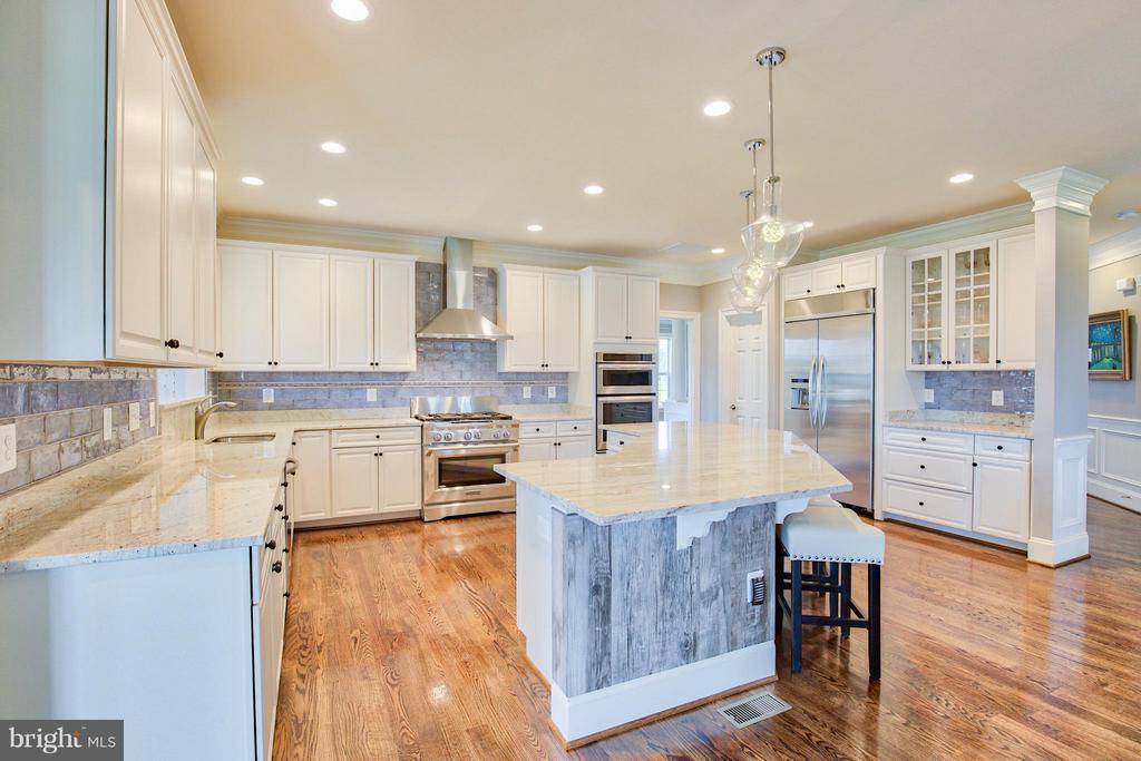 Kitchen with custom cabinetry and wood flooring - 17331 WESTHAM ESTATES CT, HAMILTON