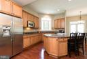 Kitchen with large center island. - 43857 RIVERPOINT DR, LEESBURG