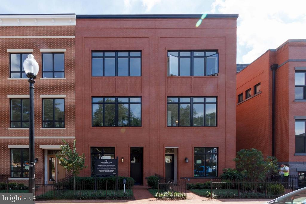 Modern, all-brick facade; large windows - 1313 D ST SE, WASHINGTON