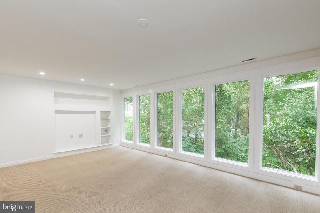 Lower level Family Room w hidden FP - 3131 MONROE ST, ARLINGTON