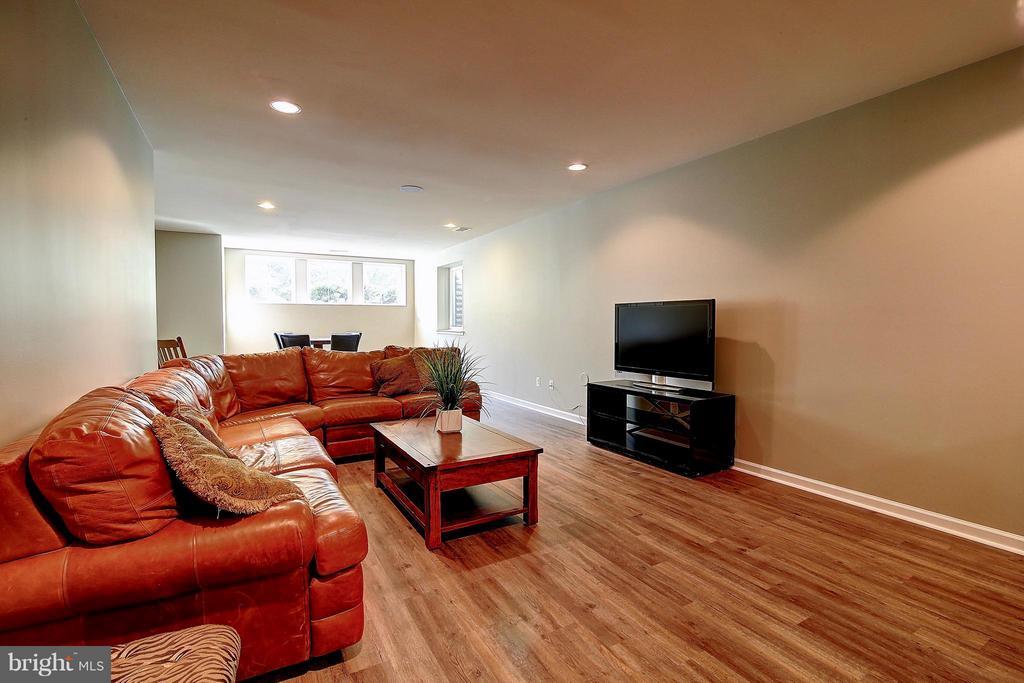 Basement with new vinyl plank flooring - 20385 SAVIN HILL DR, ASHBURN