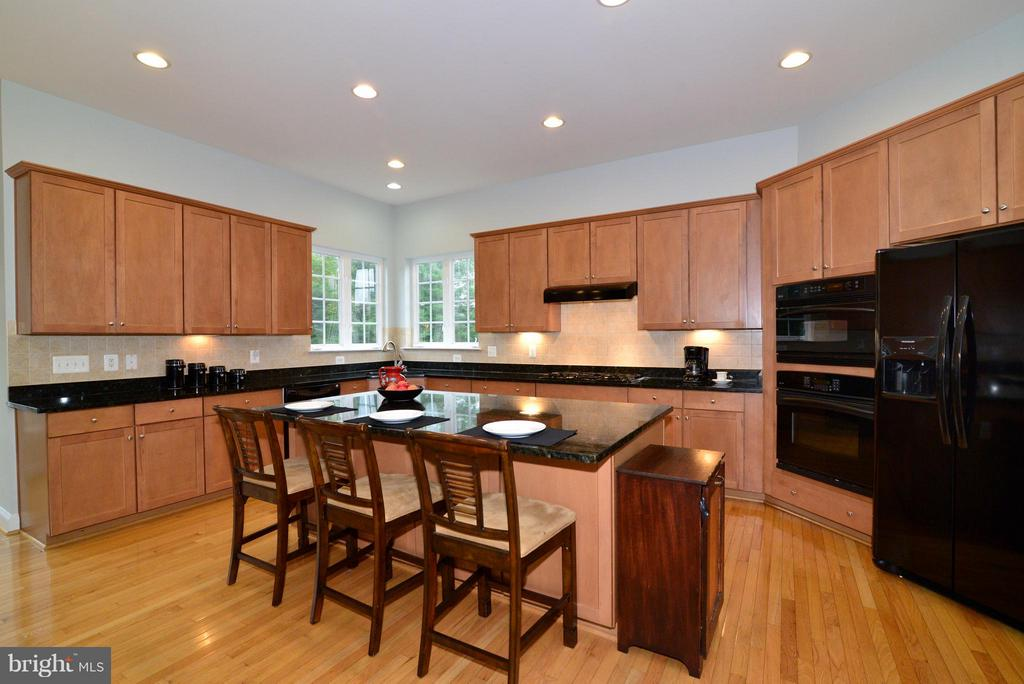 Another view of the kitchen - 13534 VILLAGE GREEN DR, LEESBURG