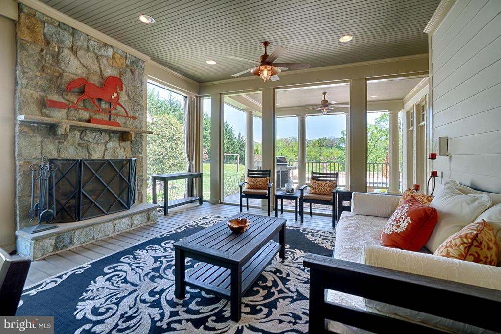 Screened in porch with fireplace - 17094 SILVER CHARM PL, LEESBURG