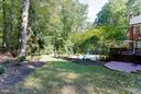 Lush gardens surrounding pool - 11102 DEVEREUX STATION LN, FAIRFAX STATION