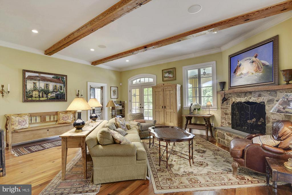 Family Room off kitchen with stone fireplace - 35387 CREEK RIDGE LN, MIDDLEBURG