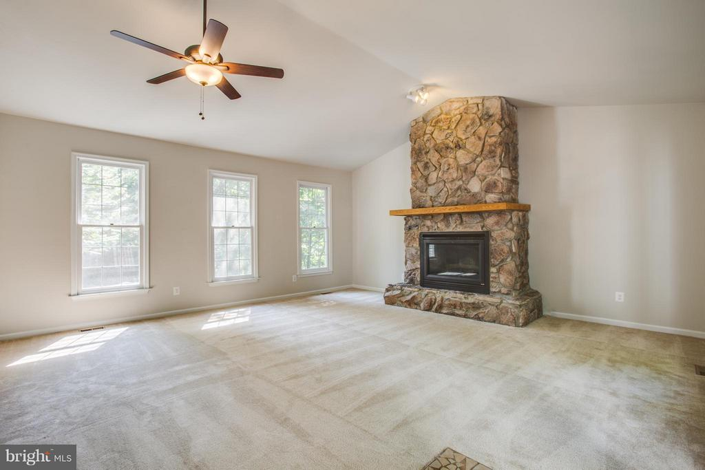 Tons of natural light and stone fireplace surround - 3418 AQUIA DR, STAFFORD