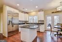 Gourmet Kitchen with Granite & Custom Backsplash - 1309 STAMFORD WAY, RESTON
