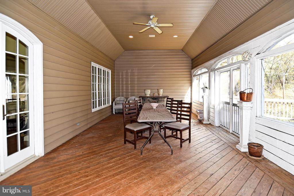 Porch with adjoining deck overlooking Little River - 23590 SALLY MILL RD, MIDDLEBURG