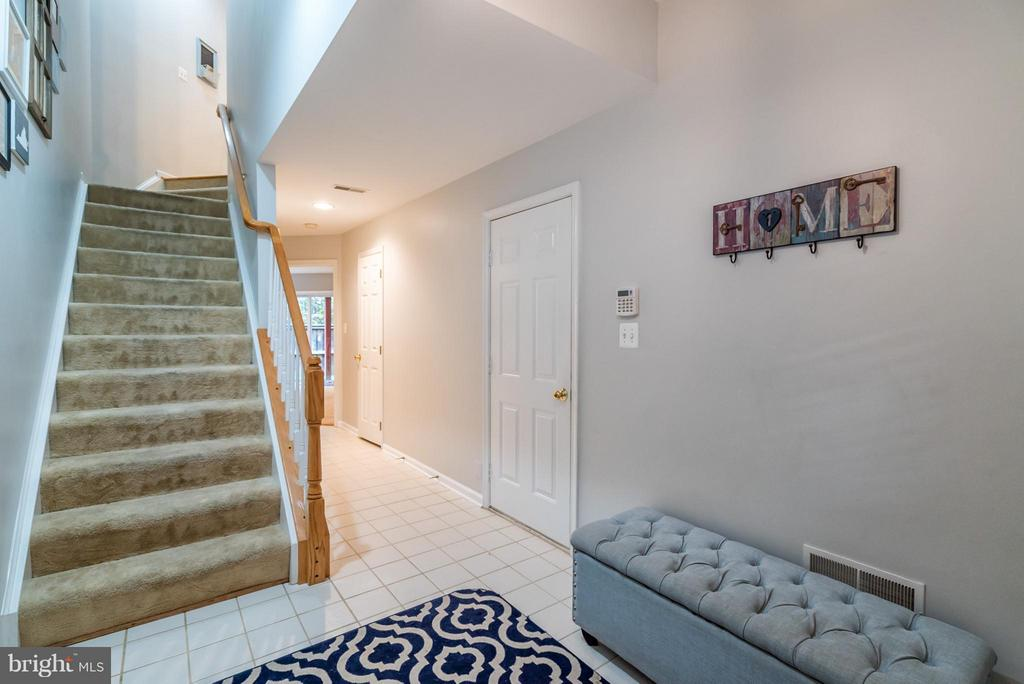 Covered Front Porch Enters to Spacious Foyer - 21436 FALLING ROCK TER, ASHBURN