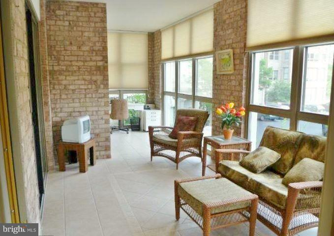 Sunroom is large and full of light. NEW SHADES! - 19370 MAGNOLIA GROVE SQ #108, LEESBURG