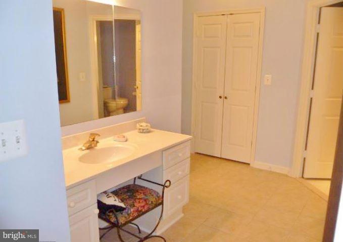 Built in vanity in Master bedroom - 19370 MAGNOLIA GROVE SQ #108, LEESBURG