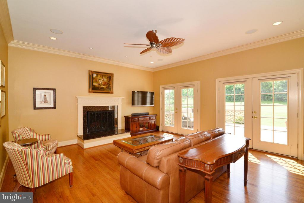 French doors lead to large outdoor deck - 41707 PUTTERS GREEN CT, LEESBURG
