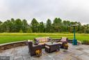 Slate Patio with Built-in Seating Backing to Trees - 41848 RAWNSLEY DR, ASHBURN
