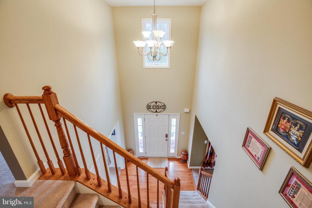 Two story foyer leading to upstairs - 2521 REGENCY DR, FREDERICKSBURG