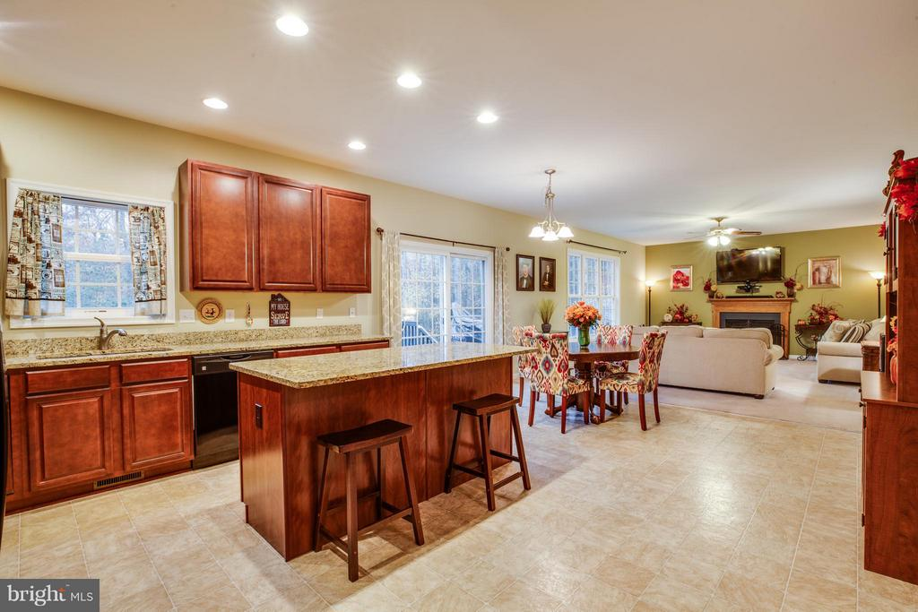 Kitchen is open to the breakfast area and FR - 2521 REGENCY DR, FREDERICKSBURG