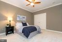 Bedroom two has crown molding and a ceiling fan. - 18332 BUCCANEER TER, LEESBURG