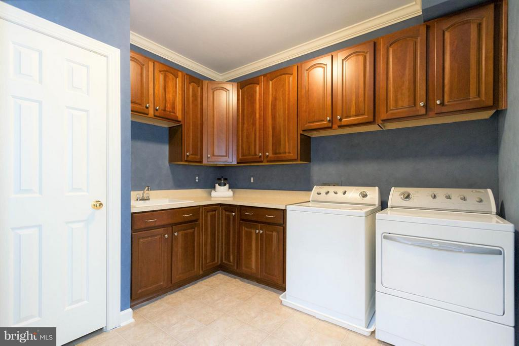 The laundry room is on the first upper level. - 18332 BUCCANEER TER, LEESBURG