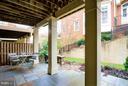 Stone patio with outdoor lighting for enjoyment. - 18332 BUCCANEER TER, LEESBURG