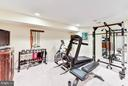 Large gym outfitted with mirrors and soft floor - 472 BELMONT BAY DR, WOODBRIDGE