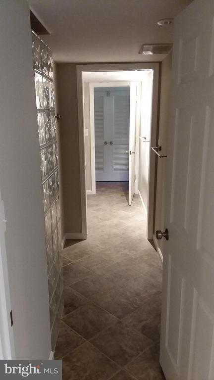 Full bath connects to bedroom, rec room, and pool - 13110 CEDAR RIDGE DR, CLIFTON