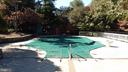 pool with cabana and deck seating area - 13110 CEDAR RIDGE DR, CLIFTON