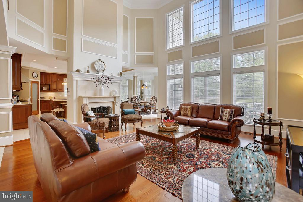 Two story family room with wood burning fireplace. - 22329 ROLLING HILL LN, GAITHERSBURG