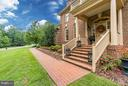 Brick path to stately front porch - 8615 LEE JACKSON CIR, SPOTSYLVANIA