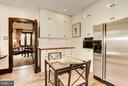 Kitchen has space for informal dining - 8110 GEORGETOWN PIKE, MCLEAN