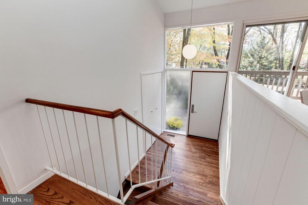 Mid=century modern greets you at the entry foyer - 7709 HAMILTON SPRING RD, BETHESDA