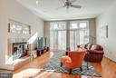 Family room off kitchen with fireplace - 11581 GREENWICH POINT RD, RESTON