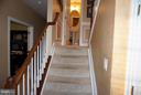 Stairs off family room to half bath - 5311 AUSTRA PL, WOODBRIDGE