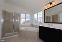 Master bathroom with separate soaking tub - 301 ADDIVON TER, PURCELLVILLE
