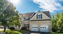 Brick Front Exterior with Two Car Garage - 24 SAINT CHARLES CT, STAFFORD