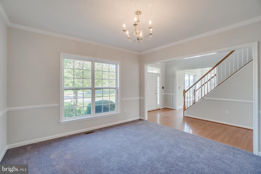 Formal Dining Room with Chair Rail, Crown Molding - 24 SAINT CHARLES CT, STAFFORD