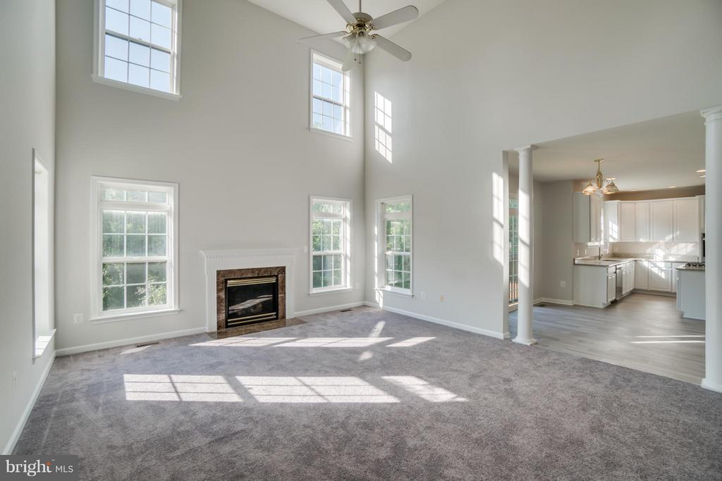 Two story Family Room with Gas Fireplace - 24 SAINT CHARLES CT, STAFFORD