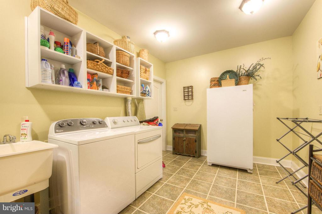 All is neat and tidy in separate laundry room - 254 SPOTTED TAVERN RD, FREDERICKSBURG