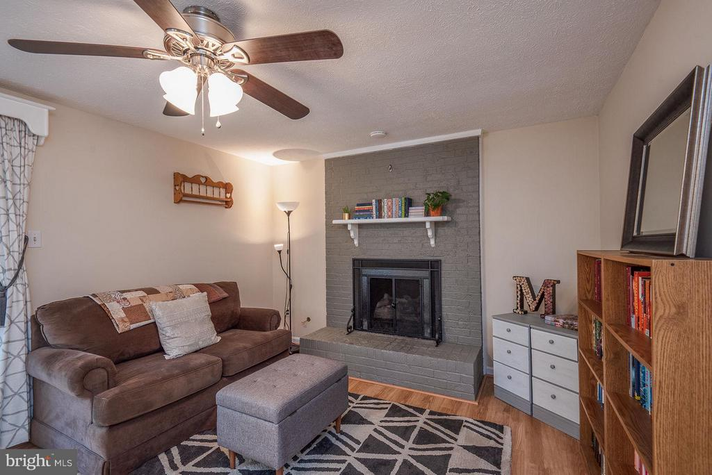 Family Room is spacious with gas fireplace. - 11 FAIRFIELD CT, STAFFORD