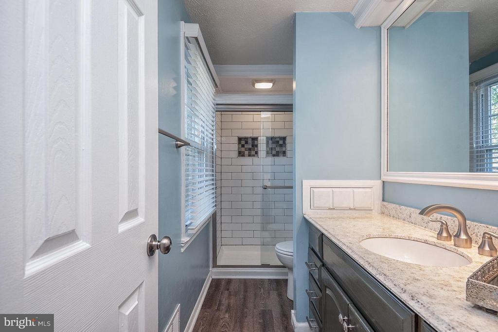 Elegantly remodeled master bath with large vanity. - 11 FAIRFIELD CT, STAFFORD