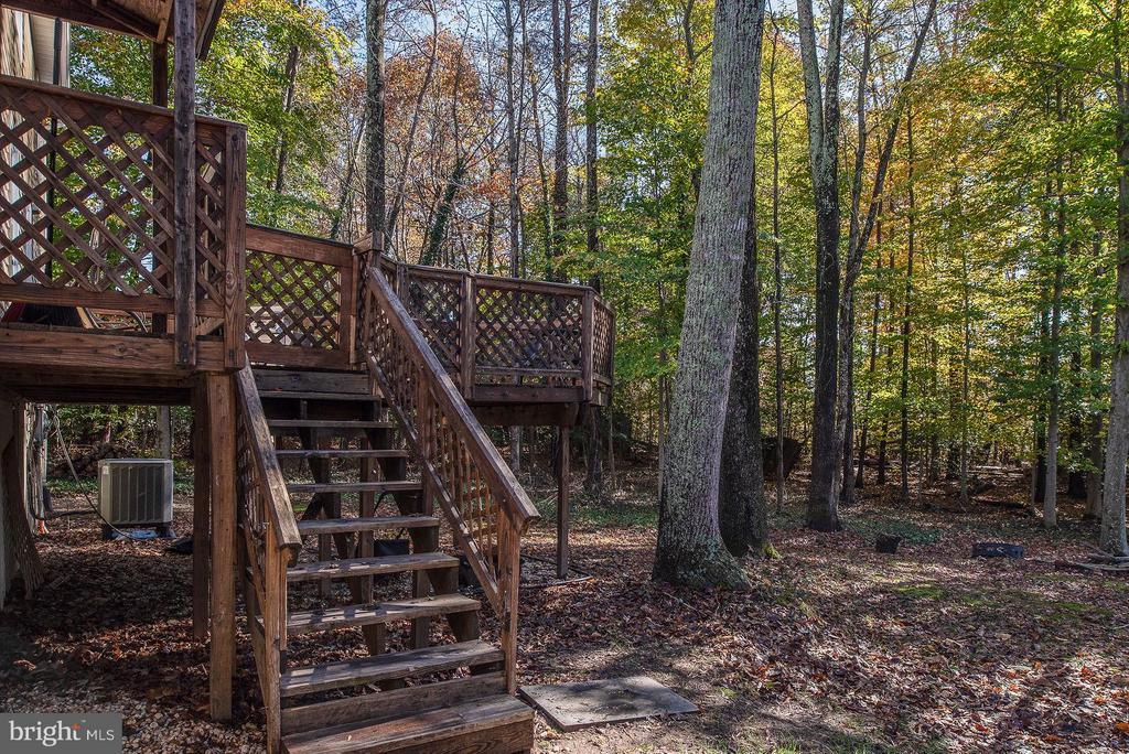 Convenient staircase off deck to your wooded yard. - 11 FAIRFIELD CT, STAFFORD